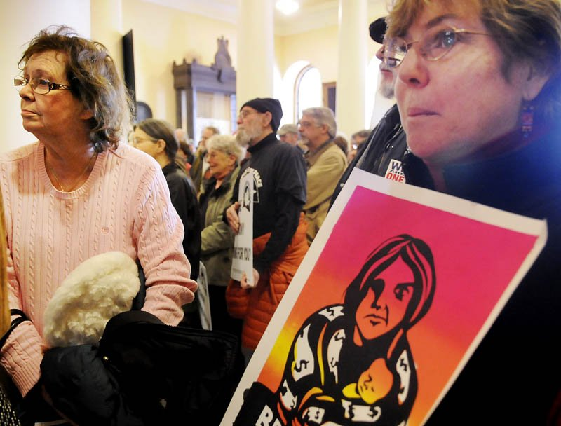 Protesters gather Monday at the State House to object to war funding and removal of murals from the Maine Department of Labor.