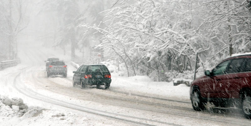 A slow-moving line of vehicles heads north on Route 27 during the April Fool's Day snowstorm in Belgrade Lakes.