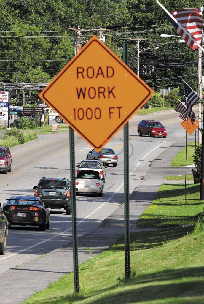 WORK AREA: Motorists pass near a construction zone located on Routes 201 and 27 in Farmingdale on Saturday evening. The state has scaled back on road work due to budget constraints.