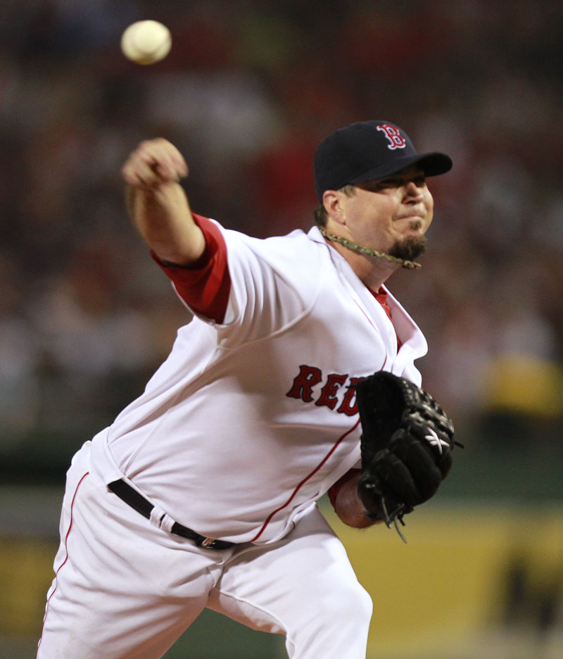 LONG, LONG NIGHT: Boston starting pitcher Josh Beckett delivers a pitch during the Red Sox 4 hour, 15 minute game against the New York Yankees on Sunday in Boston.