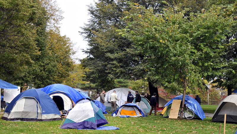 Occupy Maine reorganizes its tents this afternoon in response to a chemical bomb that exploded on the Congress Street side of Lincoln Park early Sunday morning.