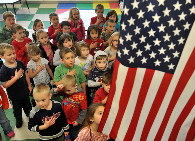 Kindergartners gather at James H. Bean Elementary School in Sidney. A new state law says schools must provide students with the opportunity to recite the Pledge of Allegiance.