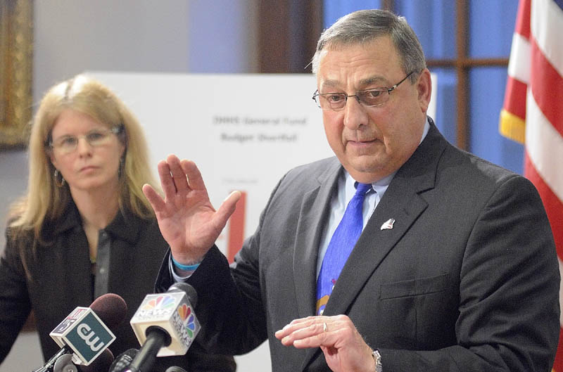 Mary Mayhew, Commissioner: Department of Health & Human Services, left, and Gov. Paul LePage answer questions during a news conference to announce changes to the MaineCare system on Tuesday in the State House's Cabinet Room in Augusta.