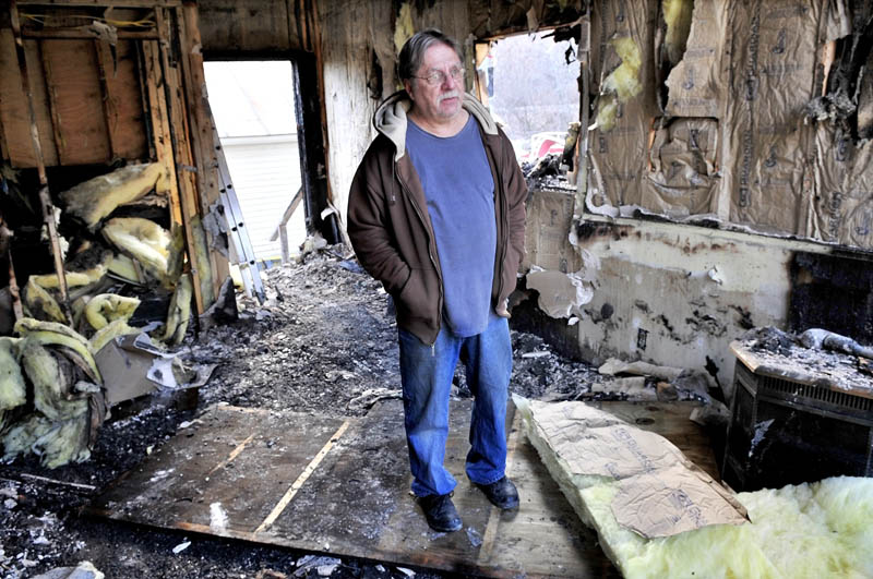DAMAGE: Victor Carrigan speaks from a room in his apartment building in Anson that was seriously damaged by fire on Monday evening. Carrigan said he plans to rebuild the structure.