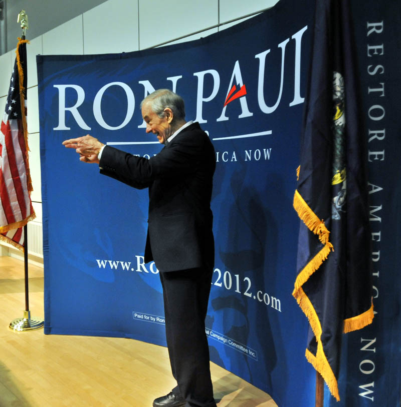 BACK AT YOU: Ron Paul greets supporters after speaking at Colby College on Friday.