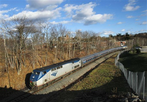 In this December 2011 photo, the Amtrak Downeaster travels through Portland. The train provides passenger rail service between Portland and Boston.