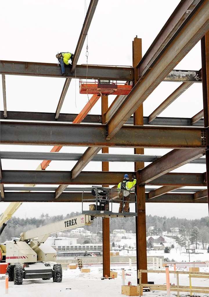 Steel workers attach beams into position Tuesday afternoon at the construction site for the new MaineGeneral hospital in North Augusta.