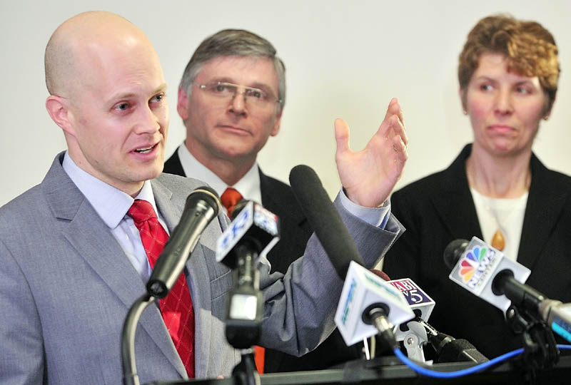 MEET THE PRESS: Maine Democratic Party Chair Ben Grant, left, introduces Senator Elect Chris Johnson during a news conference in the State House's Welcome Center on Wednesday in Augusta. Johnson's wife, Valarie Johnson, is at right. Johnson won a special election for Senate District 20 that was held to fill the seat formerly held by David Trahan, a Republican who resigned in December to become executive director of the Sportman's Alliance of Maine.