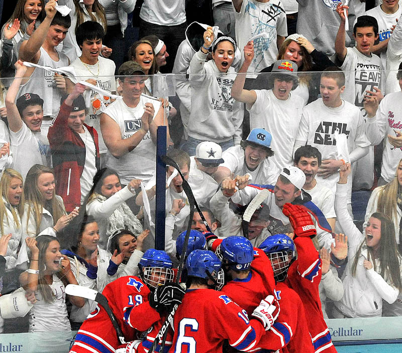 REASON TO CELEBRATE: The Messalonskee boys hockey team celebrates in front of their fans during the Eastern Maine Class B regional championship game Tuesday in Orono. The Eagles take on Greely for the state title at 1 p.m. today in Lewiston.
