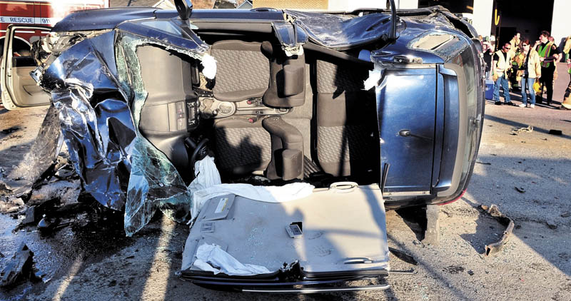 CRASH SCENE: The demolished overturned vehicle that Nancy Hazard was driving after she plowed into five vehicles parked at a traffic light in Waterville on Sunday, sending six people to the hospital. Police say she was operating at a high rate of speed on College Avenue.