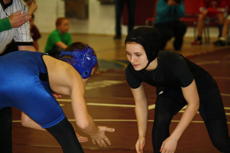 MEETING THE CHALLENGE: Monmouth eighth-grader Emily Levasseur, right, was introduced to wrestling in the sixth grade. She recently placed second in the girls New England Open in Nashua, N.H, and will now compete in the 15th annual National Girls Wrestling championships March 31 and April 1 at Eastern Michigan University in Ypsilanti, Mich.