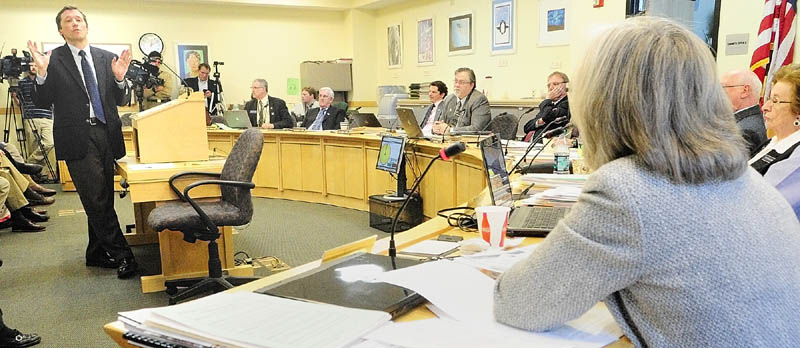 Staff photo by Joe Phelan Commissioner of Education Steve Bowen, left, answers a question from Education Committee member Rep. Mary Nelson, D-Falmouth, bottom right, during a public hearing on LD 1854 and LD1886 on Thursday afternoon in the Cross State Office Building in Augusta.