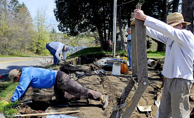 SORTING HISTORY: Archeologists with the Maine Historic Preservation Commission sort items Thursday recovered from the foundation of Fort Richmond at the head of the Richmond-Dresden bridge in Richmond. The crew will be present through the fall excavating items from the Fort erected in 1721 and decommissioned in 1755 before a new bridge is built at the site.