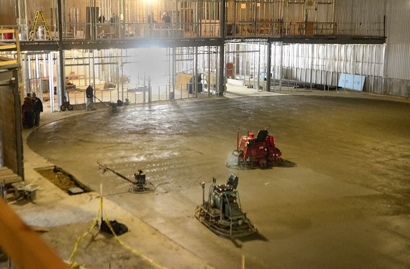 A worker finishes on Wednesday the concrete floor that will be under the ice rink at the new Bank of Maine Ice Vault in Hallowell. The refrigeration pipes are under the 260 yards of concrete and will take 28 days to cure, according to rink manager K.C. Johnson. He said that they plan to have ice by June 1.