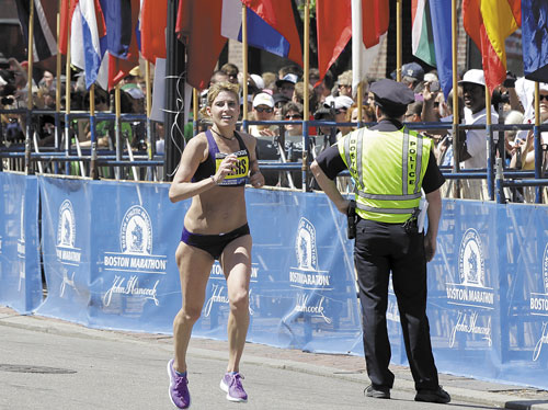 TOP AMERICAN FEMALE: Sheri Piers of Falmouth approaches the finish line of the Boston Marathon on Monday in Boston. Piers was the first American female to finish the race, coming in 10th place overall.