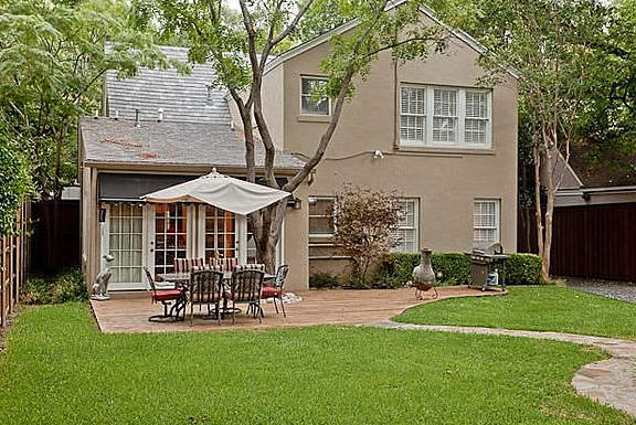 Dallas home for sale features an inviting back patio.