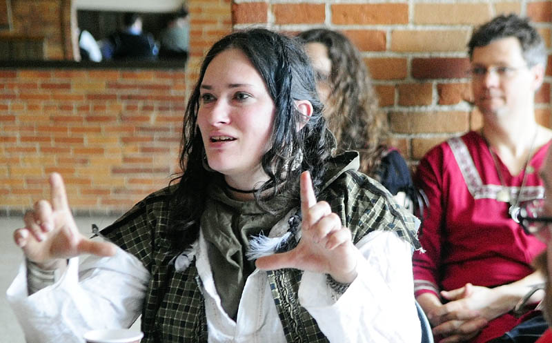 Shannon Esslinger asks a question during The East Kingdom Brewers' Collegium event sponsored by the Society for Creative Anachronism on Saturday at the River Back Dance Club in Augusta.