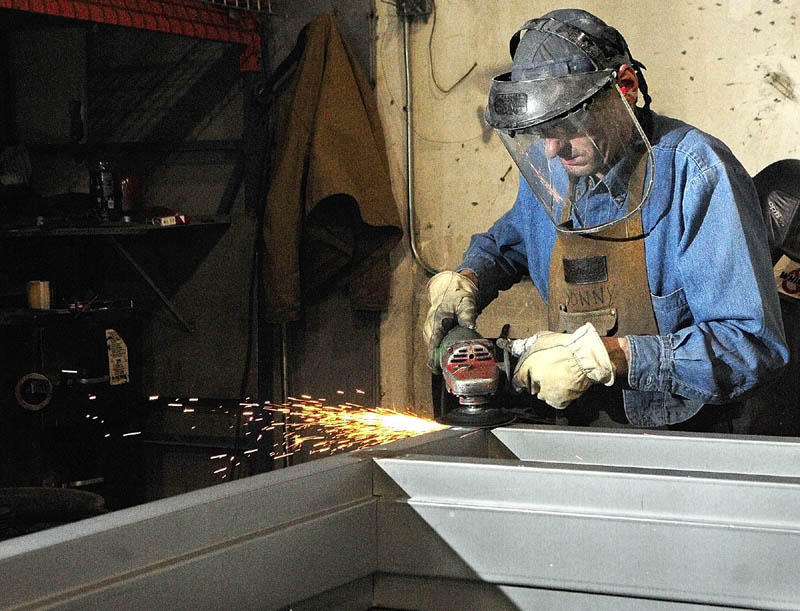 Donny Morin grinds smooth a welded joint on a door frame he is building recently at J/R Metal Frame in Belgrade. The company is building door and window frames for the new MaineGeneral regional hospital being built in Augusta.