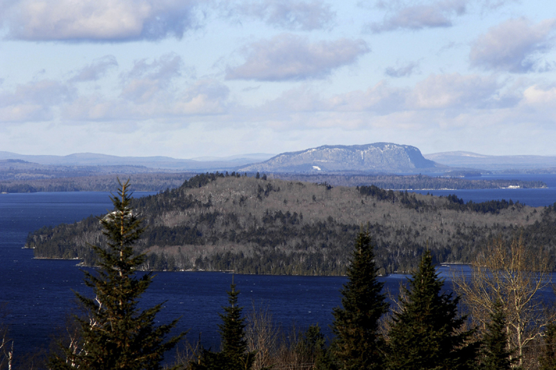 ENVIRONMENTAL CONCERNS: Moosehead Lake's iconic Mt. Kineo rises above Moosehead Lake. Representatives from The Nature Conservancy, the Forest Society of Maine and the Plum Creek timber company came together Tuesday to celebrate a new conservation easement that's considered one of the largest ever in the United States. Some, however, continue to worry that Plum Creek's current proposal will alter the landscape noticeably.
