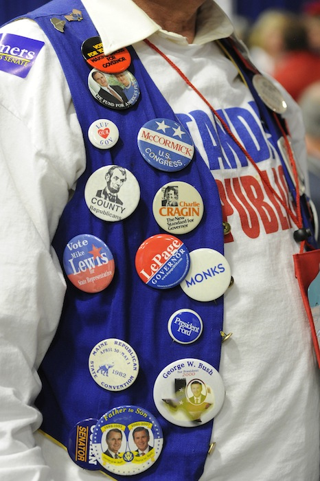 Kenn Brooks from Standish wears 52 years worth of campaign buttons at the GOP State Convention at the Augusta Civic Center on Saturday, May 5, 2012.