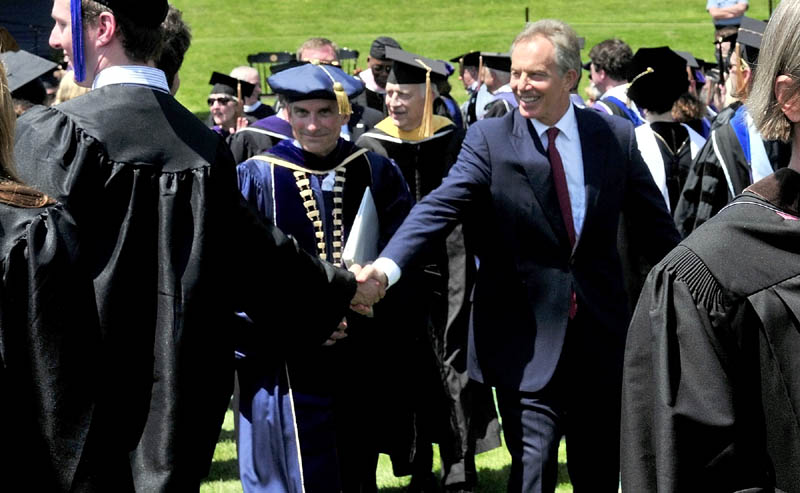 THANKS: Former Prime Minister of Britain Tony Blair shakes hands with a Colby College graduate after Blairr gave the commencerment address on Sunday. College President William Adams is left of Blair.