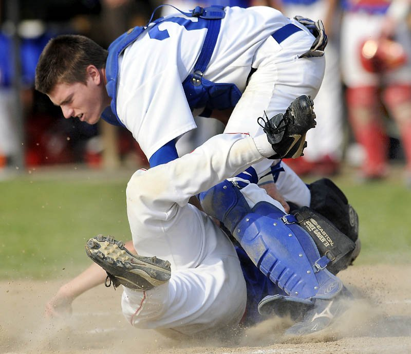 CLOSE PLAY: Messalonskee High School's Travis St. Pierre is tagged at home plate by Lewiston High School's Shawn Ricker during the Eagles' 13-2 win in the Eastern Maine Class A championship game Tuesday in Augusta.