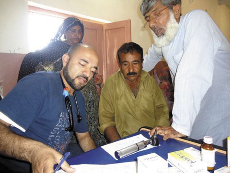 Dr. Irfan Ali, of Augusta, left, works with patients during a medical camp he offered while he was visiting family in Pakistan. For donating his time last November and other contributions, Ali, a hospitalist at MaineGeneral Medical Center's Thayer unit in Waterville, is to receive the 2011 NASF Humanitarian of the Year award from the Chelsea-based Nasreen & Alam Sher Foundation at a dinner Saturday in Augusta.