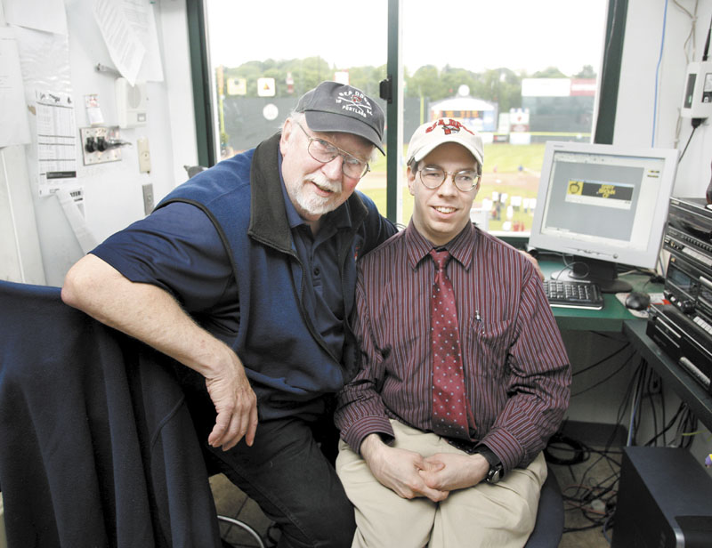 Special bond: Portland Sea Dogs announcer Dean Rogers sits with his son Mark at Hadlock Field in Portland recently. Mark, who has cerebral palsy, operates the Hadlock Field message board.