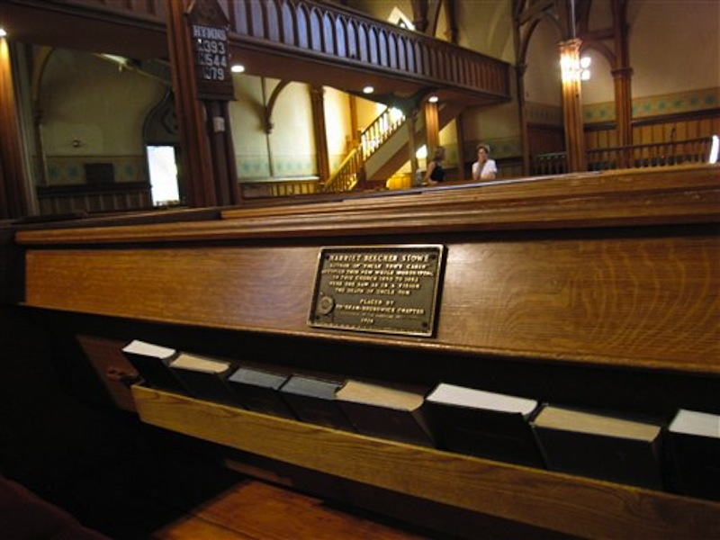 This July 13, 2012 photo shows the marker on a pew at First Parish Church in Brunswick, Maine, where