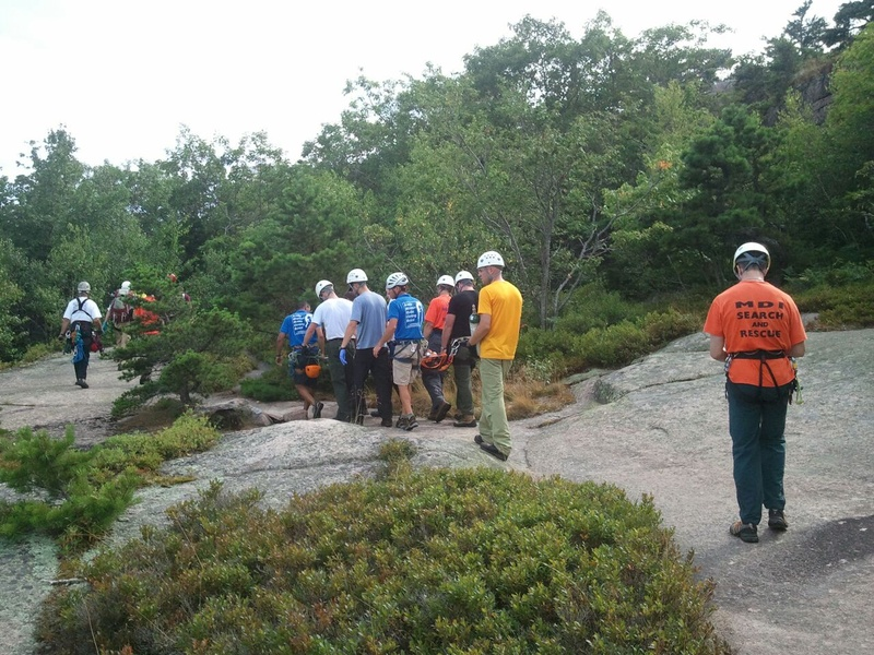 Personnel from the National Park Service, Mount Desert Island Search and Rescue, LifeFlight Of Maine and Acadia Mountain Guides assist in rescuing and giving medical care to Shirley Ladd, who was critically injured Saturday while hiking in Acadia National Park.