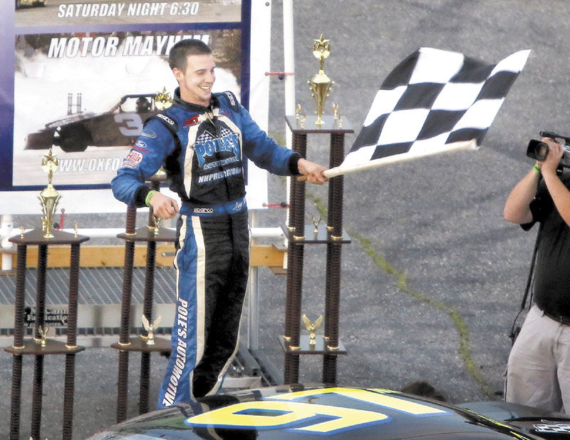 REASON TO CELEBRATE: Joey Polewarczyk, Jr. celebrates after winning the TD Bank 250 on Sunday at Oxford Plains Speedway in Oxford.