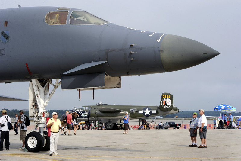 A modern B-1 bomber and a World War II B-25 bomber draw attention at The Great State of Maine Air Show in Brunswick on Saturday. This is the second year since the Brunswick Naval Air Station closed that the event has been held.