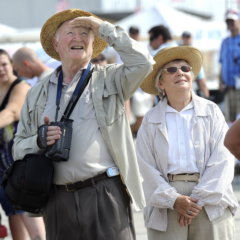 David and Martha Glass, from the Hancock County town of Sorrento, watch the performers at the Brunswick air show Saturday. Thousands of people turned out Friday and Saturday, and the event continues Sunday.