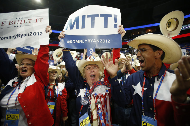Texas delegates cheer as Mitt Romney is nominated for the office of the president of the United States, at the Republican National Convention in Tampa, Fla., on Tuesday.