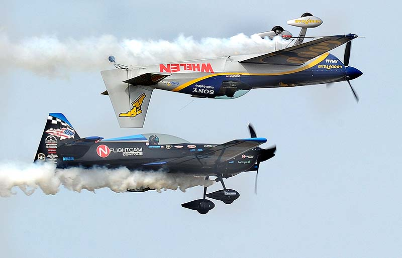 Pilot Rob Holland, bottom left, and Mike Goulian perform during The Great State of Maine Air Show at Brunswick Executive Airport on Saturday.
