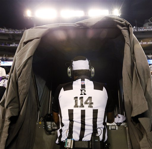 Referee Gene Steratore looks over the instant replay monitor before an NFL football game between the Baltimore Ravens and Cleveland Browns in Baltimore, Thursday, Sept. 27, 2012. (AP Photo/Patrick Semansky) NFLACTION12;