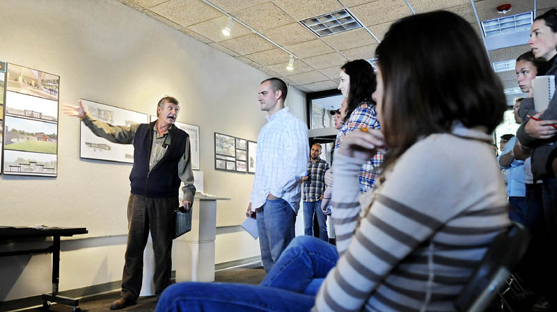 GRAND DESIGN: City of Augusta Director of Community Services Leif Dahlin discusses a design for a lodge at the Bond Brook Recreation Area with University of Maine at Augusta architecture students Monday in Augusta. Dahlin and other Judges selected two prospective designs from several submitted by the students after touring Bond Brook in early September.