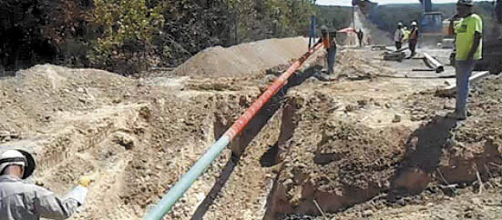 GAS IMPASSE: A still image from a video posted Tuesday on the website of Summit Natural Gas shows work crews placing and welding a 6-inch high-pressure steel pipeline in Lake of the Ozarks region, Missouri, which will serve 10 towns and about 4,000 customers. An appeals panel has found the state erred when solicited bids for a natural gas pipeline project in central Maine, awarding the bid to Central Maine Power Co.-affiliated Maine Natural Gas over Summit Natural Gas.