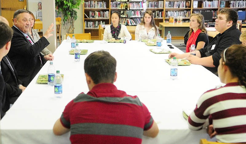 Staff photo by Joe Phelan Gov. Paul LePage, left, chats with leaders of the the Friends of Rachel group over lunch in the library on Wednesday afternoon at Erskine Academy in China. After lunch, LePage spoke about domestic abuse and violence at an all school assembly in the gym.