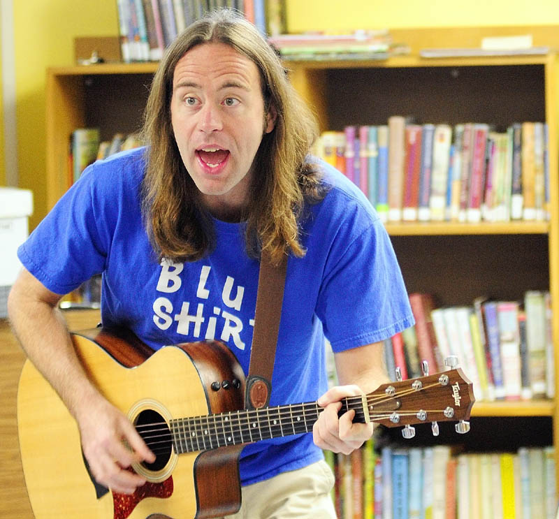 Staff photo by Joe Phelan Harley Smith, whose stage name is Mr. Harley, performs Wednesday morning in the children's room of the The Charles M. Bailey Public Library in Winthrop.