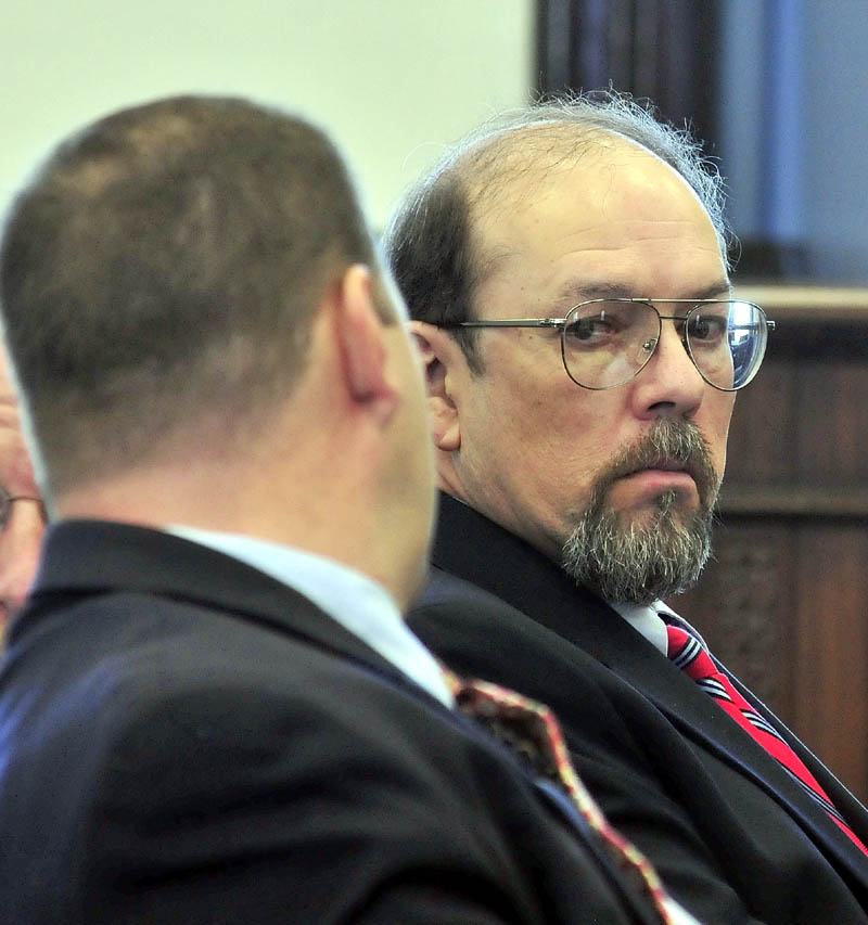 Murder defendant Jay Mercier looks around in court during his trial in Somerset County Superior Court in Skowhegan on Thursday in the death of Rita St. Peter 32 years ago.