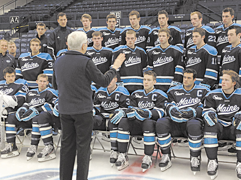 SMILE: University of Maine president Paul Ferguson talks to members of the hockey team during photo day on Wednesday in Orono.
