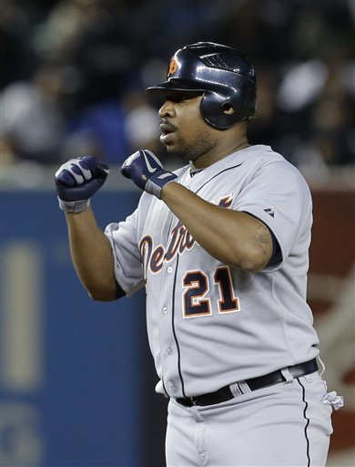 Detroit Tigers designated hitter Delmon Young gestures after driving in a run in the 12th inning of Game 1 of the American League championship series against the New York Yankees Sunday, Oct. 14, 2012, in New York. (AP Photo/Paul Sancya )