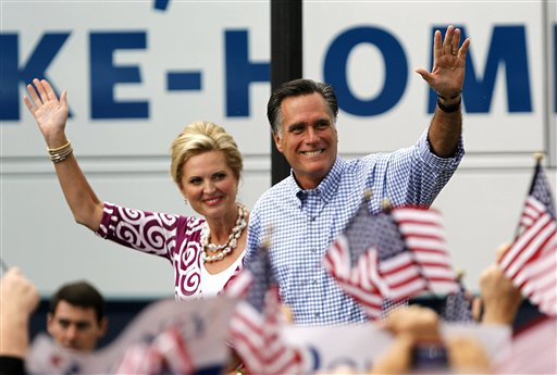 Republican presidential candidate Mitt Romney waves as he arrives with his wife Ann at a campaign rally, Sunday, in Port St. Lucie, Fla.