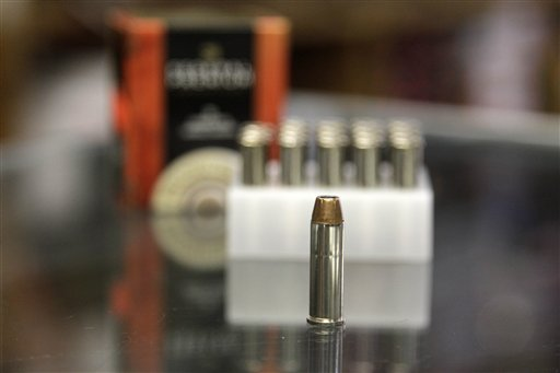 A box of ammunition is seen on the counter of a gun shop in Tinley Park, Ill. A Cook County officials is proposing a tax of five cents a bullet. and a dollar for a box of 20.