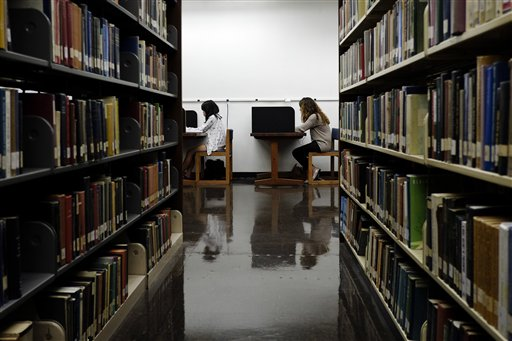 Students study recently on the campus of California State University, Long Beach in Long Beach, Calif. With higher education costs shifting from the states to families and the federal government, the California State University system, which educates 427,000 students, has said it will have to increase tuition again as soon as this winter.