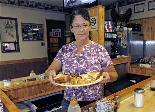 Millie Brown, a cook and waitress at Buch's truck stop, serves a breakfast, in Steubenville, Ohio., recently. U.S. service companies grew in September at the fastest pace since March.
