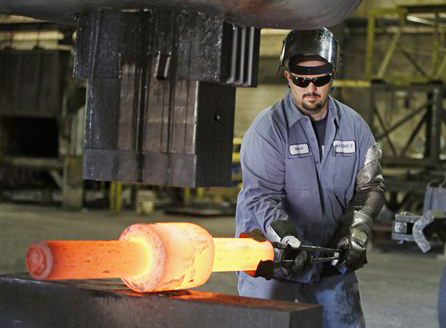 Jack Knox positions a hot spindle being shape at Solmet Technologies in Canton, Ohio. US unemployment fell to 7.8 percent Friday, a 44-month low.