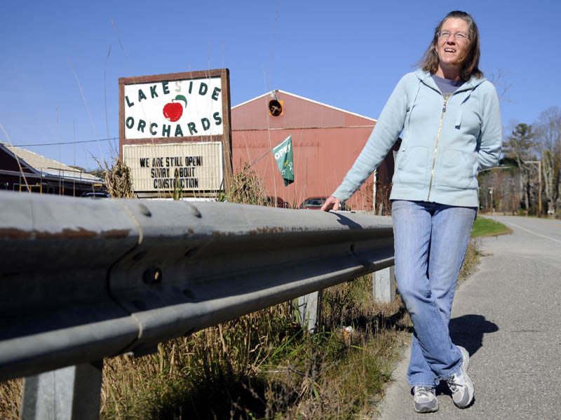 Lakeside Orchards retail manager Paula McDougal removed signs around the store and orchard along Route 17 in Manchester posted by political candidates.