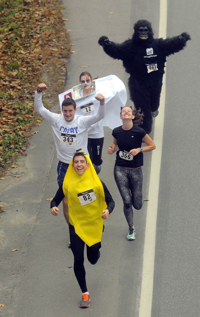 Participants in the 4th annual Freaky 5k Run and Walk hosted by Hardy Girls Healthy Women Colby Volunteer Center run up Mayflower Hill Drive near Colby College Saturday.